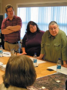 The Mi'kmawey Debert staff meet with the Elders' Advisory Council often. Here project director Tim Bernard and administrator Sheila Pierro review maps of the Debert area with Elder Judy Bernard Julian.