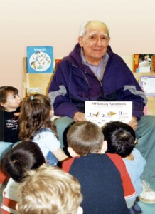 The late Elder Raymond Cope sharing stories, thoughts, knowledge, and feelings with children in the Millbrook Community.