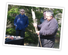 MDCC Program Development Officer Gerald Gloade demonstrates an atlatl (an ancient spear-thrower) at the Mi'kmawey Debert Interpretive Trail.