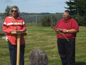 Elder Douglas Knockwood and MDCC staff member Gerald Gloade offer prayers in a celebration of remembrance at St. Brigid's Cemetery in Parrsboro, NS. The Mi'kmawey Debert Cultural Centre is committed to the continuation of these traditional practices.