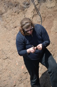 Leah Rosenmeier, MDCC Research and Interpretation Specialist, looks at some of the lithic material (i.e. rocks!) at Cape d'Or in July 2013.