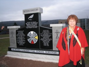 Elder Phyllis Googoo stands by the Indian Residential School Commemoration monument at Waycobah First Nation in December 2012 Waycobah, Nova Scotia.
