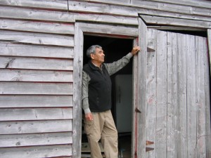 Elder Douglas Knockwood (Indian Brook First Nation) has shared many stories with us about his life and his family beginning at Newville Lake and continuing through to the present. Here, in 2006, he stands at his Uncle Henry's house in Newville Lake, NS.