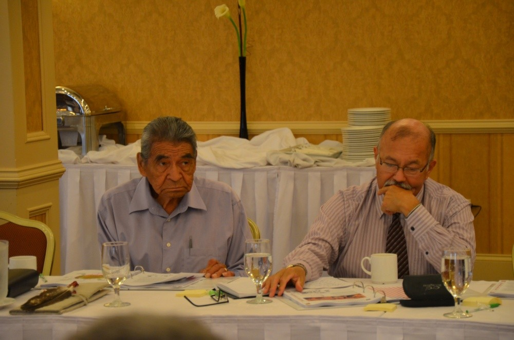 Elder Douglas Knockwood (Sipekne'katik First Nation) sits with Donald Julien (Millbrook First Nation), Executive Director of The Confederacy of Mainland Mi'kmaq and member of the Netukulimk (Economic, Social, and Political Life) group.
